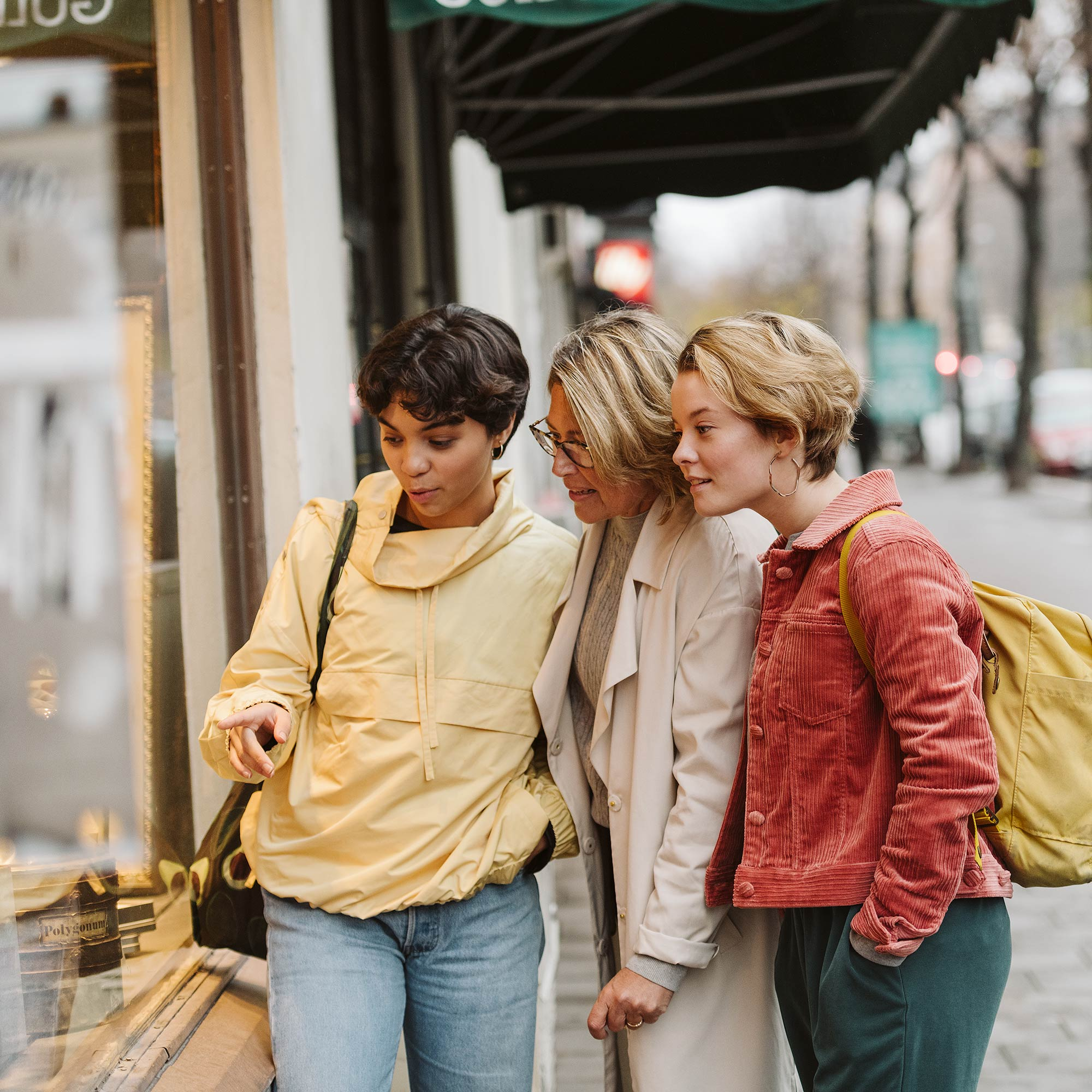 Three women window shopping.